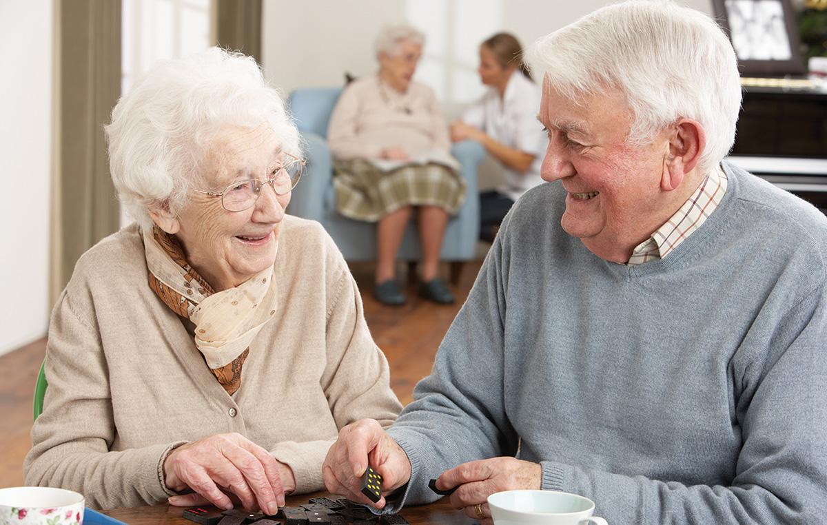 elderly couple playing dominoes